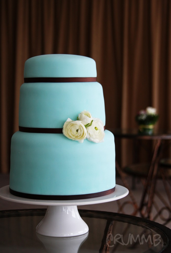 teal layer cake with choclate and flowers